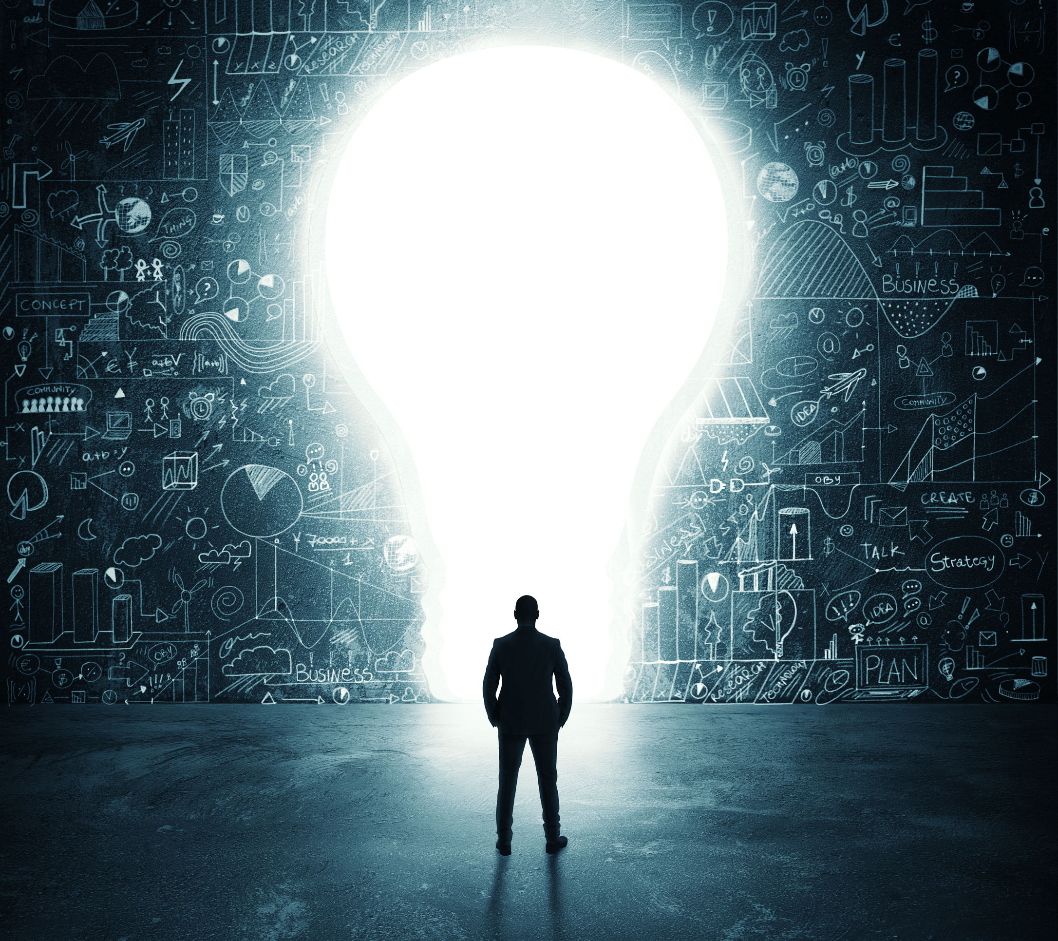64803573 - businessman looks at a big hole in the shape of a light bulb on the wall